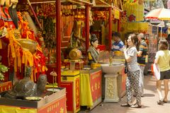 Woman praying at the Buddhist shrine. In Singapore at Bugis district of the city Royalty Free Stock Photography