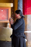 Woman praying in a Buddhist temple Stock Photo