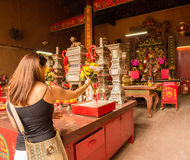 Woman praying at Buddhist Temple Stock Photos