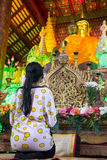 Woman praying at Buddhist temple Royalty Free Stock Image
