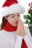 Woman praying at Christmas Stock Photography