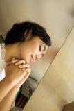 Woman praying in church. Portrait of asian young woman praying in church Stock Photo