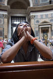 Woman praying in the church Stock Photography