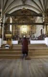 Woman praying in church stock image