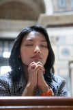 Woman praying in church Royalty Free Stock Photo