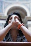 Woman praying in church Stock Photos