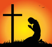 woman praying before the crucifix Royalty Free Stock Images