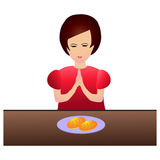 Woman praying during dinner Royalty Free Stock Photos