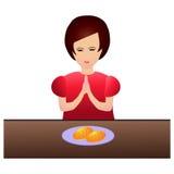 Woman praying during dinner Royalty Free Stock Photos