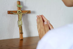 Woman praying in front of christian cross, faith, religioun concept Stock Photo