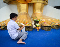 A woman praying at Giant Buddha in Bangkok, Thailand Royalty Free Stock Photography