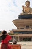 Woman praying the Giant buddha and burning incense at the Fo Guang Shan of Taiwan, Kaohiung Royalty Free Stock Image