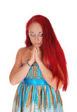 Woman praying with hands folded. Royalty Free Stock Photo