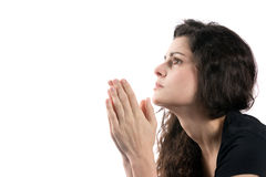 Woman Praying Hands. Woman prays while looking up with her hands together Royalty Free Stock Photography