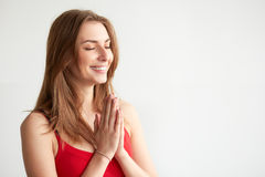 Woman praying hands together, namaste, yoga. Royalty Free Stock Photo