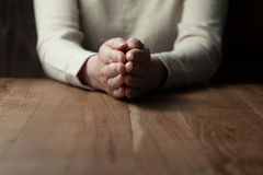 Woman praying hands. On wooden background Royalty Free Stock Images
