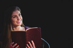 Woman praying with her bible Stock Photo
