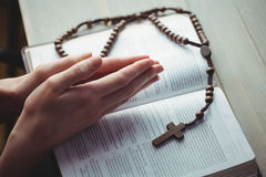 Woman praying with her bible Royalty Free Stock Photo