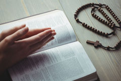 Woman praying with her bible. On table Royalty Free Stock Photos