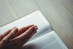 Woman praying with her bible Stock Photography