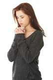 Woman praying with her hands together. Young woman praying with her hands together Stock Images