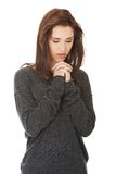 Woman praying with her hands together. Young woman praying with her hands together Royalty Free Stock Photos