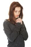Woman praying with her hands together Royalty Free Stock Images