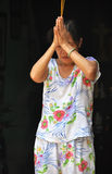 Woman Praying in Hoi An, Vietnam Stock Photos