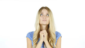 Woman praying , hoping for best , forgiveness, White Background. High quality royalty free stock photo