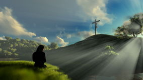 Woman praying at Jesus cross against beautiful sun rays, panning stock footage