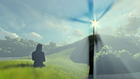 Woman praying at Jesus cross over beautiful sun rays stock footage