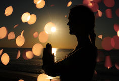 Woman praying or meditating Royalty Free Stock Images