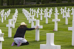 Woman praying in a memorial cemetery Royalty Free Stock Images