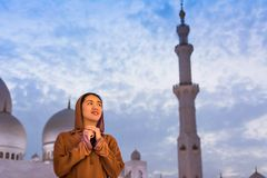 Woman praying in the mosque at dusk. Asian woman praying in the mosque at dusk Royalty Free Stock Photography