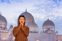 Woman praying in the mosque at dusk. Asian woman praying in the mosque at dusk Stock Photos