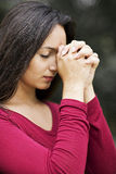 Woman praying outdoors Royalty Free Stock Photography