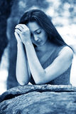 Woman praying outdoors Royalty Free Stock Images