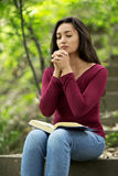 Woman praying outdoors Stock Photography