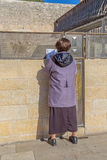 Woman praying outside of the Wailing Wall. JERUSALEM, ISRAEL - FEBRUARY 28, 2014: Woman praying outside of the Wailing Wall, The Western Wall or Kotel which is Royalty Free Stock Photography