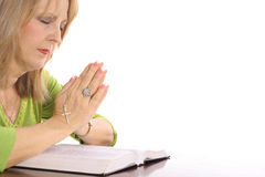 Woman praying over bible Royalty Free Stock Photos