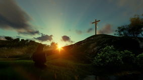 Woman praying over Jesus cross against beautiful timelapse sunrise stock video footage
