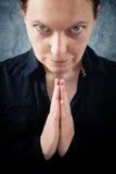 Woman praying and praising the God. Religion, spirituality concept Royalty Free Stock Image
