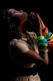 Woman praying profile. Young african american praying in dim light Stock Images