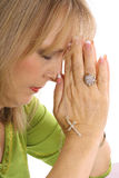 Woman praying with rhinestone cross upclose. Isolated on a white background Stock Images