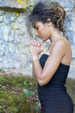 Woman praying with a rosary Royalty Free Stock Image