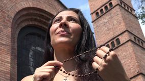 Woman Praying with Rosary Beads stock video
