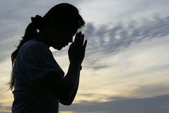 Woman praying silhouette Royalty Free Stock Photos