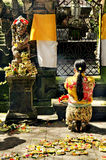 Woman praying in temple bali indonesia Royalty Free Stock Photo