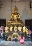 Woman praying to Buddha in temple Bangkok. Woman praying to Buddha Royalty Free Stock Photography