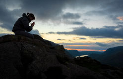 Woman Praying. A woman praying to God on the summit of a mountain Stock Photos